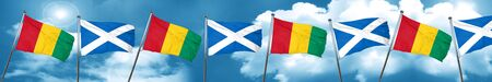 scottish culture: Guinea flag with Scotland flag, 3D rendering