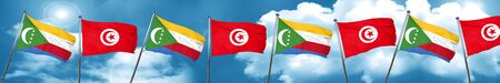 Comoros flag with Tunisia flag, 3D rendering Stock Photo