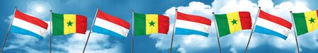 Luxembourg flag with Senegal flag, 3D rendering