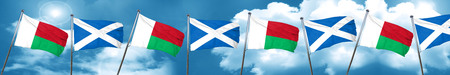 Madagascar flag with Scotland flag, 3D rendering