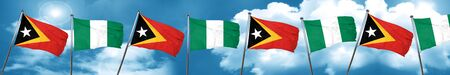 country nigeria: east timor flag with Nigeria flag, 3D rendering