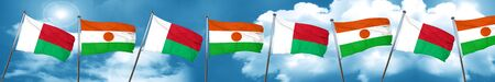 Madagascar flag with Niger flag, 3D rendering