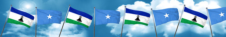 somalia: Lesotho flag with Somalia flag, 3D rendering