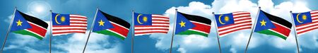 south sudan flag with Malaysia flag, 3D rendering