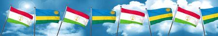Tajikistan flag with rwanda flag, 3D rendering Stock Photo