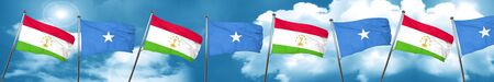 somalia: Tajikistan flag with Somalia flag, 3D rendering Stock Photo