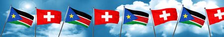 south sudan flag with Switzerland flag, 3D rendering
