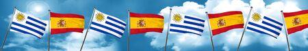 combines: Bandera de Uruguay con la bandera de España, representación 3D Foto de archivo
