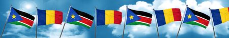 south sudan flag with Romania flag, 3D rendering