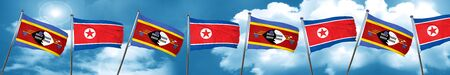 Swaziland flag with North Korea flag, 3D rendering