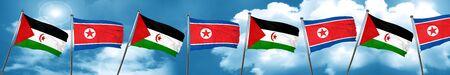 Western sahara flag with North Korea flag, 3D rendering