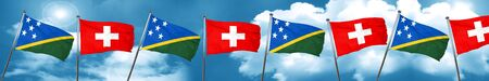 Solomon islands flag with Switzerland flag, 3D rendering Stock Photo