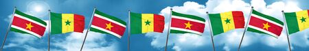 Suriname flag with Senegal flag, 3D rendering