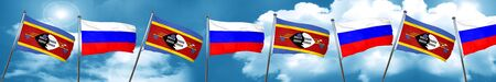 Swaziland flag with Russia flag, 3D rendering