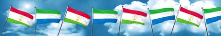 sierra: Tajikistan flag with Sierra Leone flag, 3D rendering Stock Photo