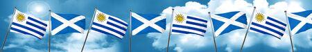 bandera de uruguay: Bandera de Uruguay con la bandera de Escocia, representación 3D Foto de archivo