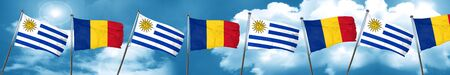 bandera de uruguay: Bandera de Uruguay con la bandera de Rumania, representación 3D Foto de archivo