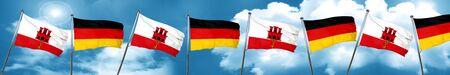 german culture: gibraltar flag with Germany flag, 3D rendering
