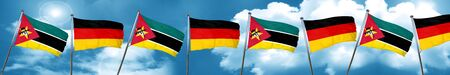 Mozambique flag with Germany flag, 3D rendering