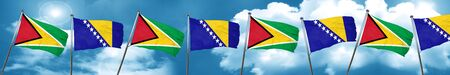 Guyana flag with Bosnia and Herzegovina flag, 3D rendering