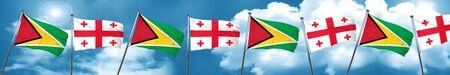 georgian: Guyana flag with Georgia flag, 3D rendering