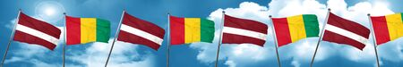Latvia flag with Guinea flag, 3D rendering