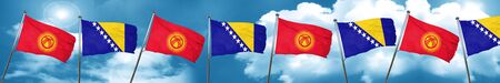 Kyrgyzstan flag with Bosnia and Herzegovina flag, 3D rendering