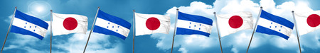 bandera honduras: Honduras flag with Japan flag, 3D rendering Foto de archivo