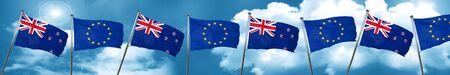Bandera de Nueva Zelanda con la bandera de la Unión Europea, representación 3D Foto de archivo