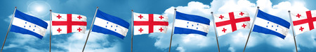georgia: Honduras flag with Georgia flag, 3D rendering