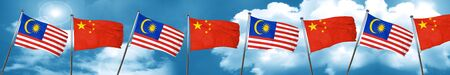 Malaysia flag with China flag, 3D rendering Stock Photo