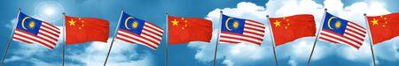 vlag van Maleisië met de vlag van China, 3D-rendering Stockfoto