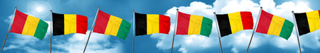 Guinea flag with Belgium flag, 3D rendering