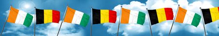 Ivory coast flag with Belgium flag, 3D rendering