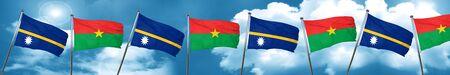 Nauru flag with Burkina Faso flag, 3D rendering Stock Photo