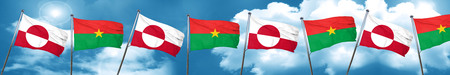 greenland flag with Burkina Faso flag, 3D rendering