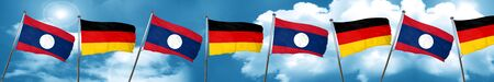 german culture: Laos flag with Germany flag, 3D rendering