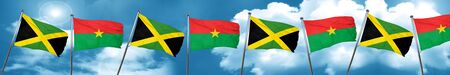 jamaican: Jamaica flag with Burkina Faso flag, 3D rendering
