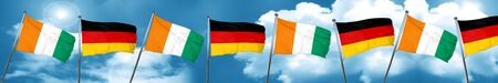 german culture: Ivory coast flag with Germany flag, 3D rendering