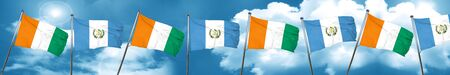 Ivory coast flag with Guatemala flag, 3D rendering Stock Photo