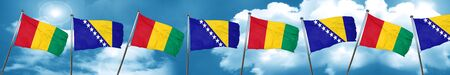Guinea flag with Bosnia and Herzegovina flag, 3D rendering Stock Photo