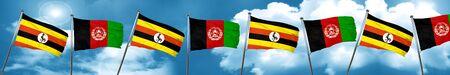 afghan: Uganda flag with afghanistan flag, 3D rendering Stock Photo