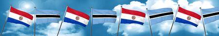 bandera de paraguay: Paraguay flag with Botswana flag, 3D rendering Foto de archivo