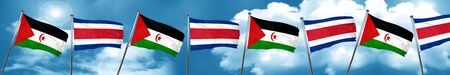 Western sahara flag with Costa Rica flag, 3D rendering