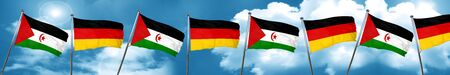 Western sahara flag with Germany flag, 3D rendering