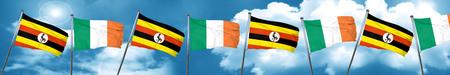 Bandera de Uganda con la bandera de Irlanda, representación 3D Foto de archivo