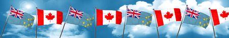 Bandera de Tuvalu con la bandera de Canadá, representación 3D Foto de archivo