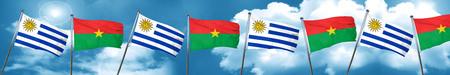 bandera de uruguay: Uruguay flag with Burkina Faso flag, 3D rendering Foto de archivo
