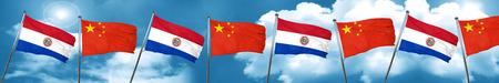 bandera de paraguay: Bandera de Paraguay con la bandera de China, representación 3D Foto de archivo