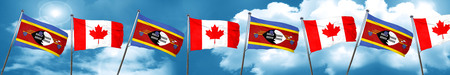 Swaziland flag with Canada flag, 3D rendering